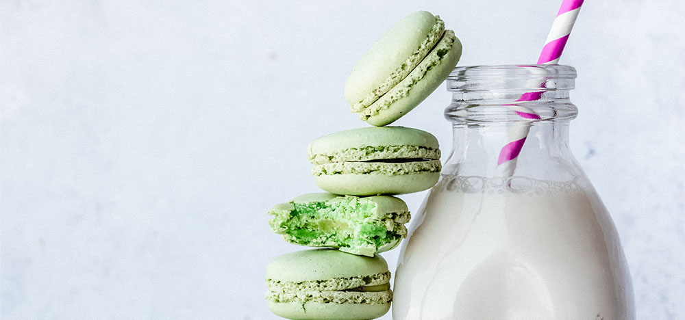 Neo Mint Macaroon in stack with oat milk coffee