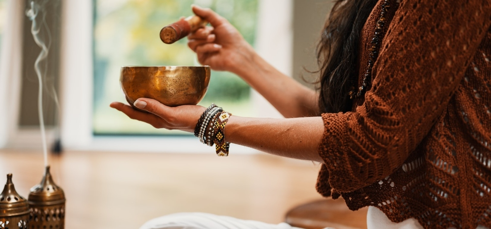 woman meditating with sound bowl